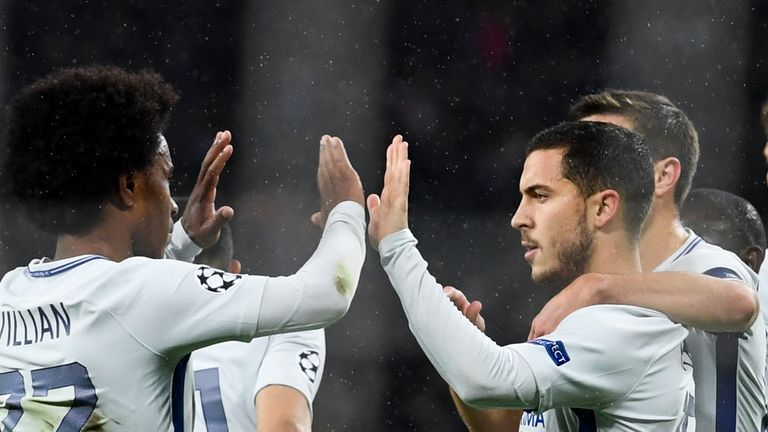 Chelsea's midfielder from Belgium Eden Hazard (R) celebrates after scoring a goal from the penalty spot during the UEFA Champions League Group C football m