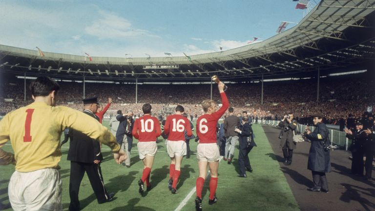 England captain Bobby Moore running a lap of honour around Wembley Stadium after England beat West Germany in the World Cup Final 4 - 2, 30th July 1966. (P