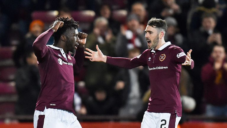 Hearts' Esmael Goncalves (L) celebrates his goal with teammate Michael Smith