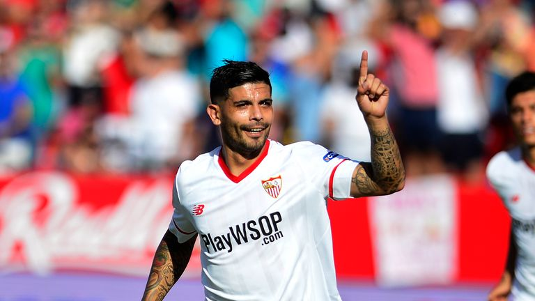 Sevilla's Argentinian midfielder Ever Banega celebrates after scoring a goal during the Spanish league football match Sevilla FC vs Malaga CF at the Ramon