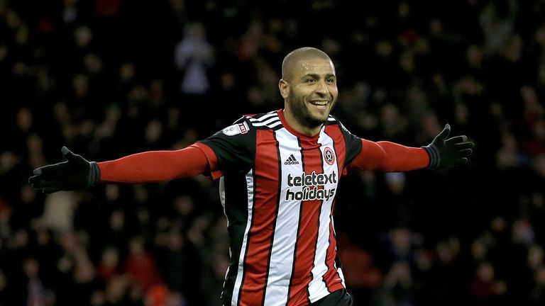 Leon Clarke celebrates after completing his hat-trick