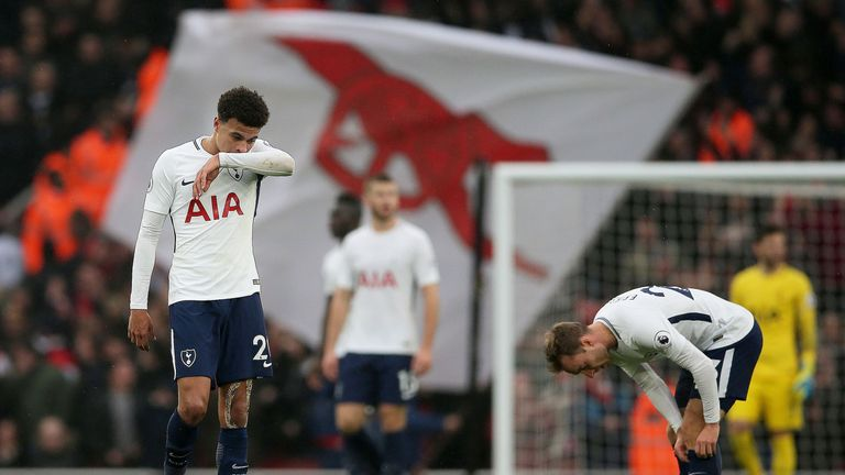 Dele Alli reacts to Tottenham going two goals down at the Emirates