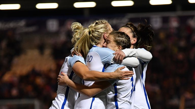 England's Fran Kirby of England (2R) celebrates with her team-mates after scoring from the penalty spot