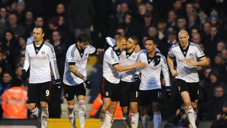 Steve Sidwell of Fulham is kissed by teammate Adel Taarabt  after scoring a goal to level the scores at 1-1
