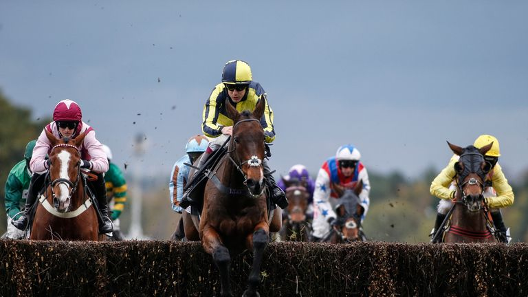 Aidan Coleman and Go Conquer (C) lead all the way to win the Sodexo Gold Cup Handicap Steeple Chase