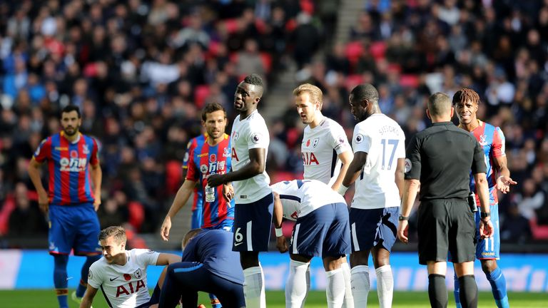 Spurs midfielder Harry Winks receives treatment against Palace