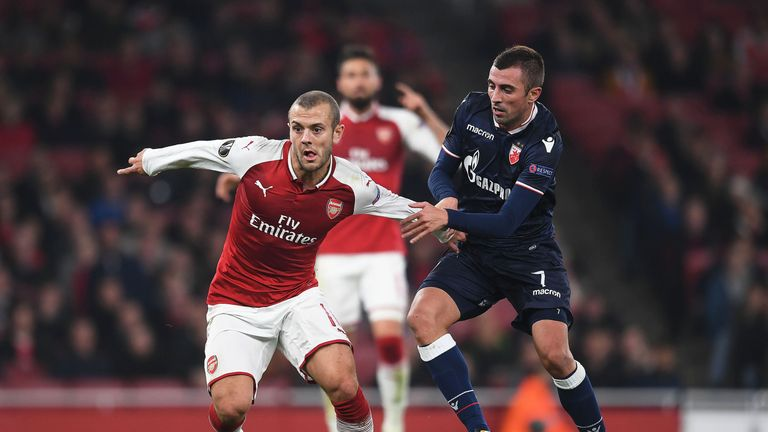 Jack Wilshere takes on Red Star Belgrade's Nenad Krsticic during the UEFA Europa League group H match at Emirates Stadium