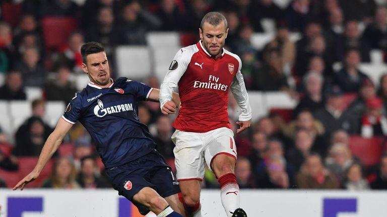 Arsenal midfielder Jack Wilshere (R) is tackled by Red Star Belgrade's midfielder Marko Gobeljic