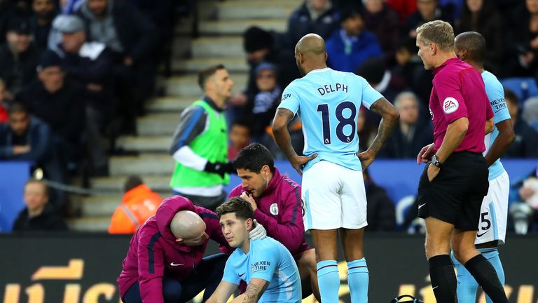 John Stones of Manchester City receives medical treatment against Leicester City