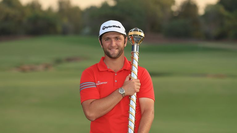Jon Rahm poses with the trophy after winning the 2017 DP World Tour Championship