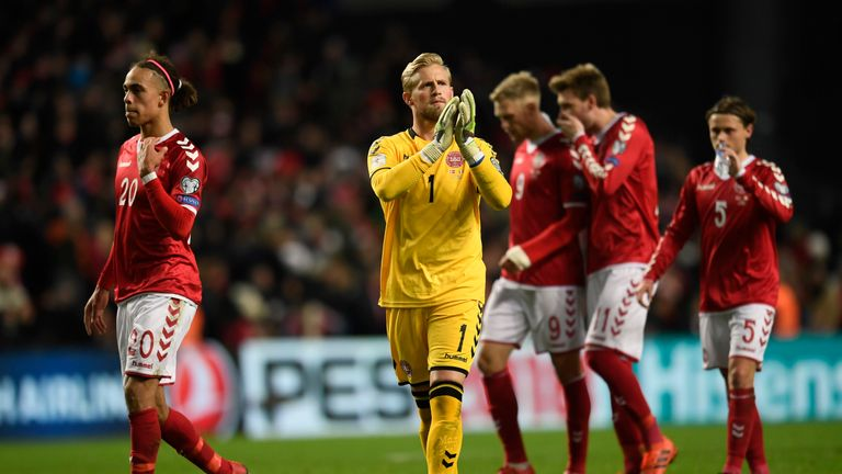 Yussuf Poulsen (L) and goalkeeper Kasper Schmeichel (C) of Denmark react after the play-off FIFA World Cup 2018 qualification football match of Denmark vs