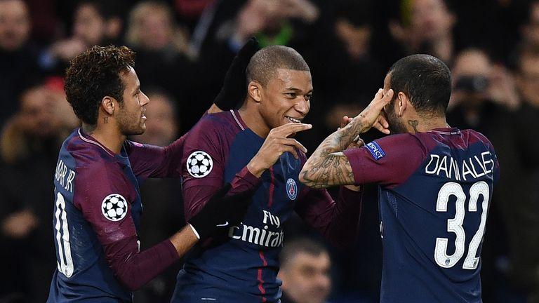Paris Saint-Germain's Kylian Mbappe (centre) celebrates with Neymar (L) and Dani Alves (R) after scoring against Celtic