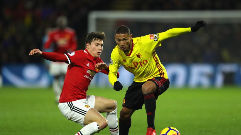 WATFORD, ENGLAND - NOVEMBER 28:  Richarlison de Andrade of Watford evades Victor Lindelof of Manchester United during the Premier League match between Watf