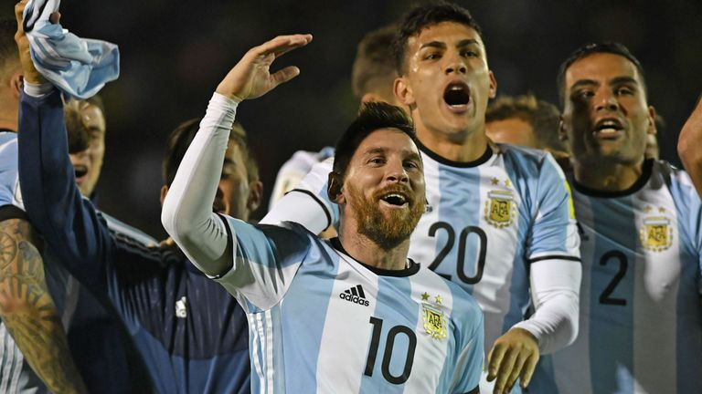 Argentina's Lionel Messi (C) celebrates after defeating Ecuador and qualifying to the 2018 World Cup football tournament, in Quito, on October 10, 2017. /