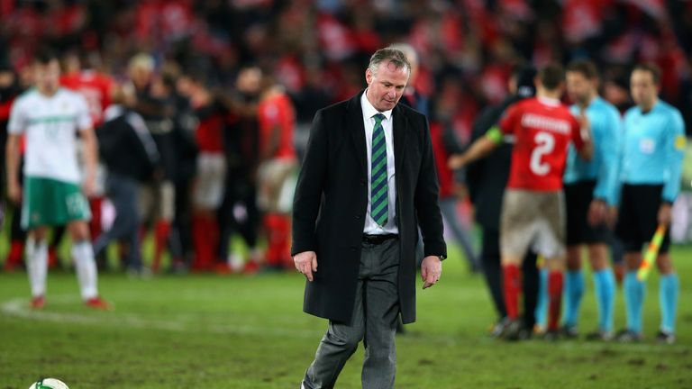 Michael O'Neill, manager of Northern Ireland looks dejected