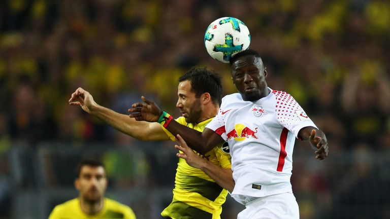 Naby Keita rises for a header during a meeting between RB Leipzig and Borussia Dortmund