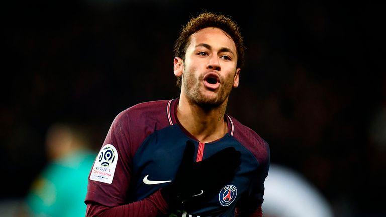 Paris Saint-Germain's Brazilian forward Neymar celebrates after scoring a goal during the French L1 football match between Paris Saint-Germain (PSG) and Tr