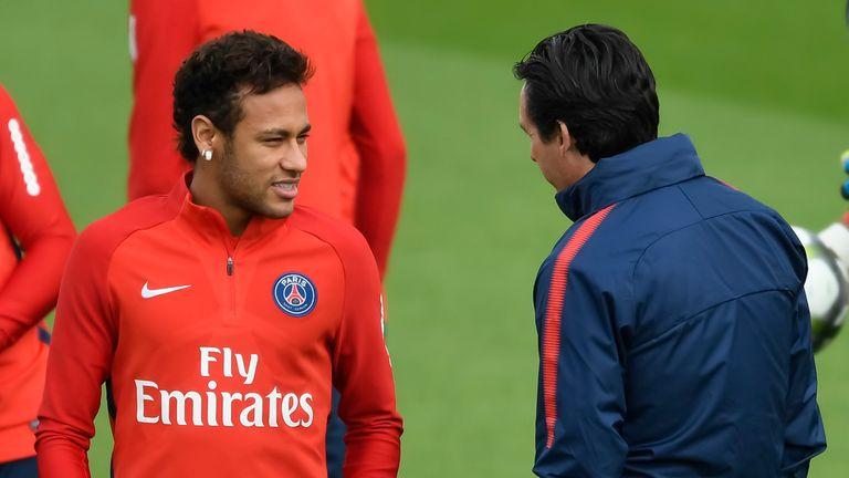 Paris Saint-Germain's Brazilian forward Neymar (L) speaks with Paris Saint-Germain's Spanish head coach Unai Emery during a training session in Saint-Germa