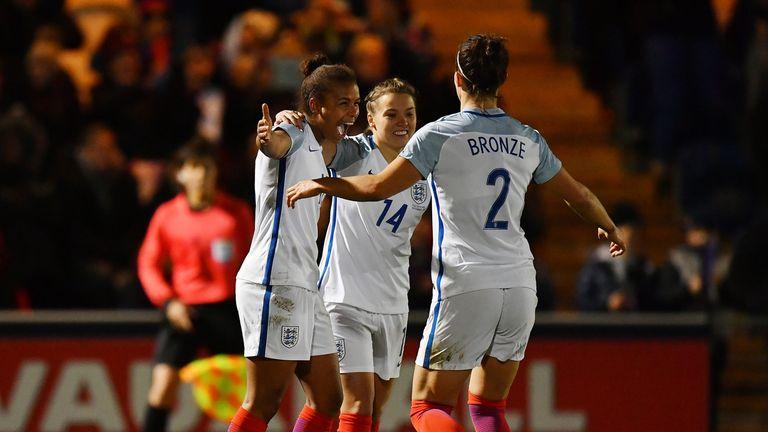 Nikita Parris (L) celebrates scoring England's third