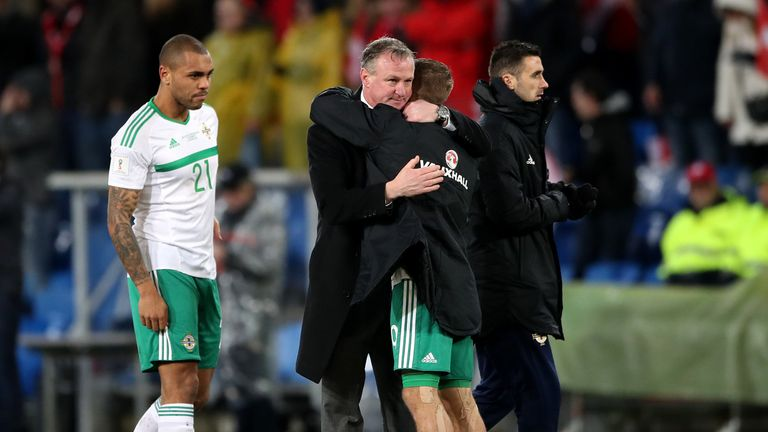 Northern Ireland manager Michael O'Neill embraces Jamie Ward after the FIFA World Cup Qualifying second leg match at St Jakob Park, Basel.