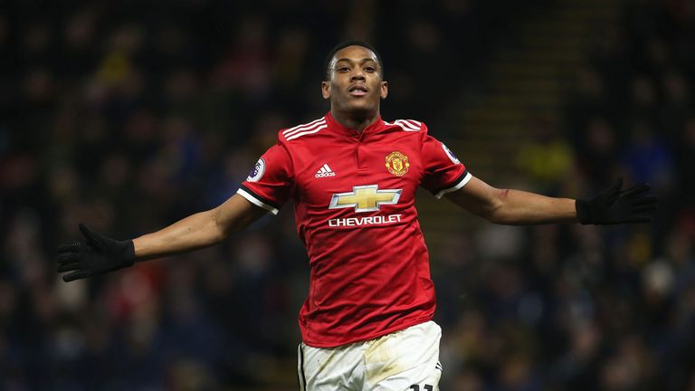Anthony Martial celebrates after making it 3-0