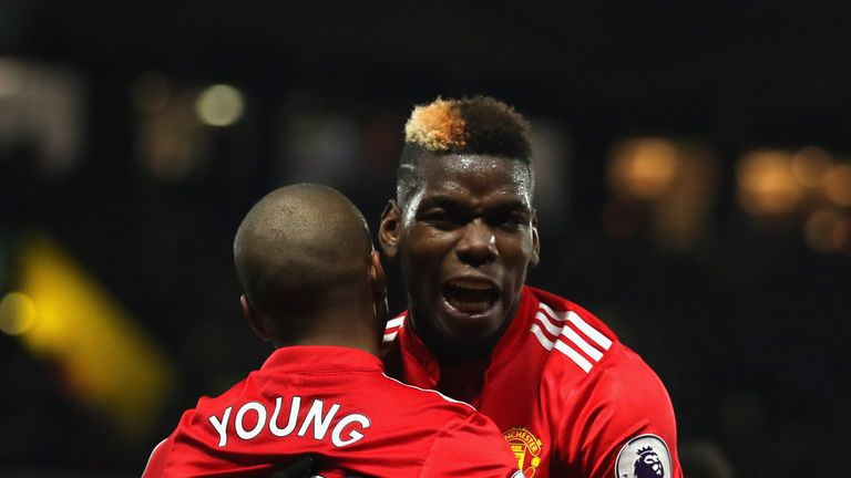 Young is congratulated for his second goal of the game by Paul Pogba