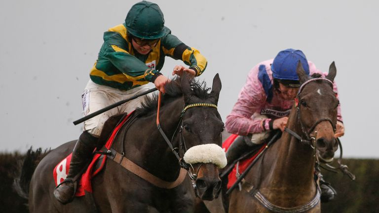 Bryony Frost riding Present Man clear the last to win the Badger Ales Trophy at Wincanton
