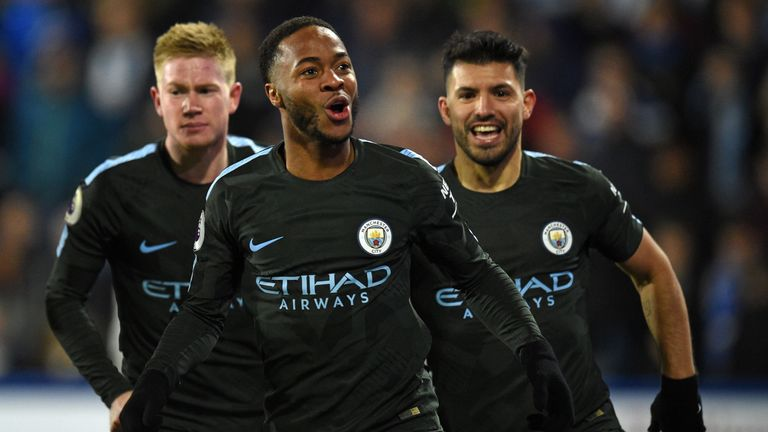 Manchester City's English midfielder Raheem Sterling celebrates after scoring their second goal during the English Premier League football match between Hu