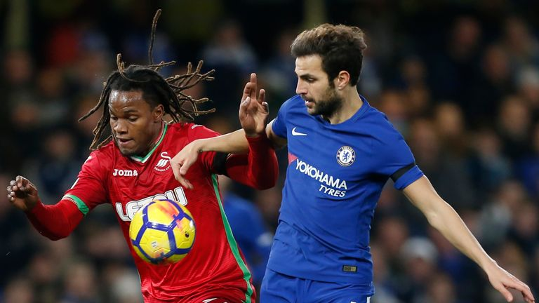 Renato Sanches and Cesc Fabregas in action at Stamford Bridge