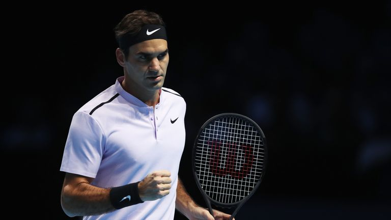 Roger Federer of Switzerland celebrates a point during the Singles Semi Final match against David Goffin of Belgium