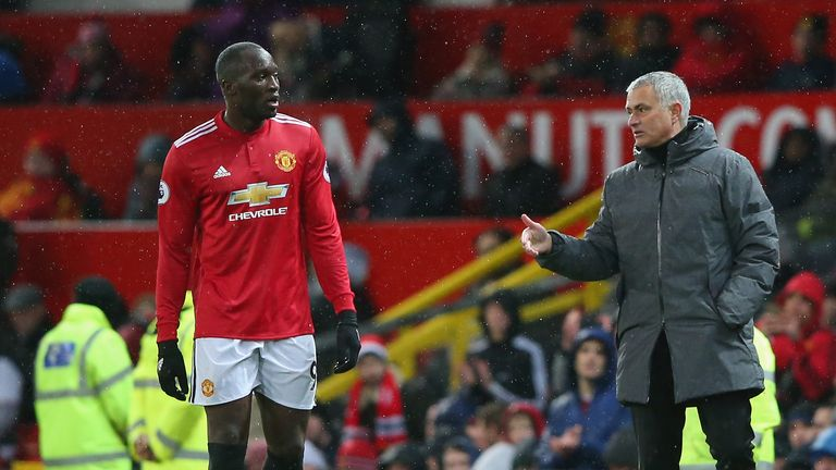 MANCHESTER, ENGLAND - NOVEMBER 25:  Romelu Lukaku speaks with Jose Mourinho, Manager of Manchester United during the Premier League match between Mancheste