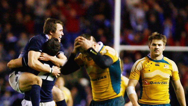 Scotland celebrate as Matt Giteau of Australia reacts to his missed conversion