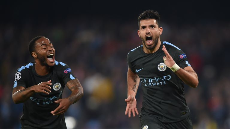 Sergio Aguero (R) celebrates after scoring in the UEFA Champions League football match Napoli vs Manchester City