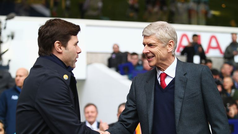 LONDON, ENGLAND - MARCH 05:  Arsene Wenger manager of Arsenal and Mauricio Pochettino manager of Tottenham Hotspur shake hands prior to the Barclays Premie
