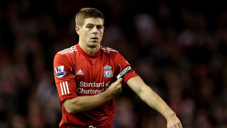 LIVERPOOL, ENGLAND - DECEMBER 26:  Steven Gerrard of Liverpool puts on the captain's armband during the Barclays Premier League match between Liverpool and