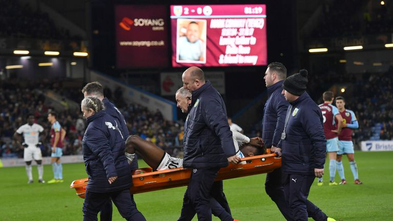 Swansea City's Tammy Abraham is stretchered off following a challenge by Burnley's Charlie Taylor