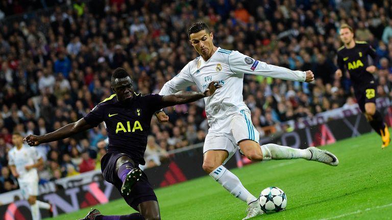 TOPSHOT - Real Madrid's Portuguese forward Cristiano Ronaldo (R) vies with Tottenham Hotspur's Colombian defender Davinson Sanchez during the UEFA Champion