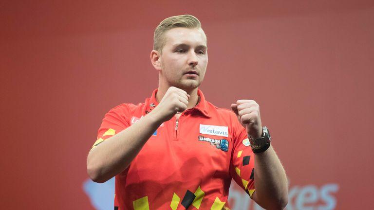 Dimitri Van den Bergh claimed an impressive win over Raymond van Barneveld in Glasgow (Picture: Steve Welsh/PDC)