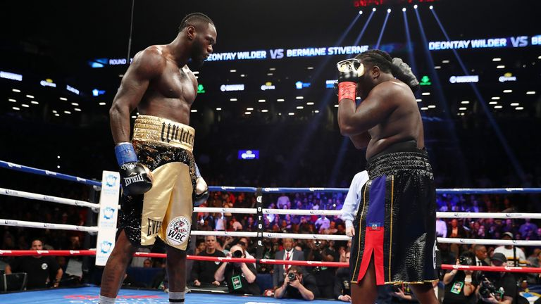 NEW YORK, NY - NOVEMBER 04:  Deontay Wilder stares down Bermane Stiverne after knocking him down and the fight resumed in the first round during their rema