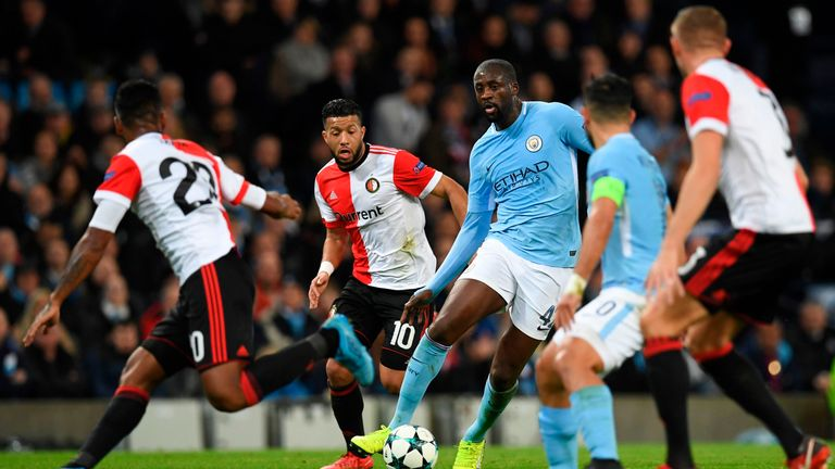 Yaya Toure (C) runs at the Feyenoord defence