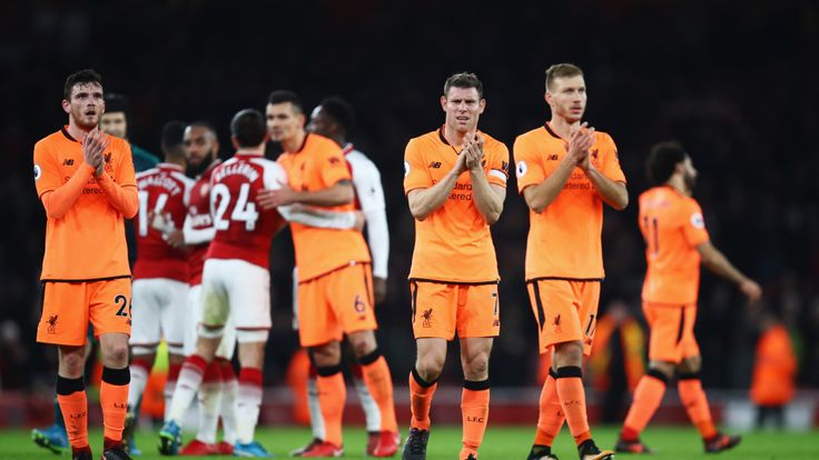 James Milner and Ragnar Klavan of Liverpool applaud the travelling fans after the Premier League match against Arsenal.