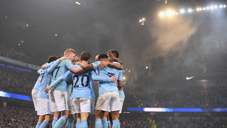 Raheem Sterling of Manchester City celebrates after scoring his side's fourth goal in the win over Tottenham at the Etihad Stadium in December 2017