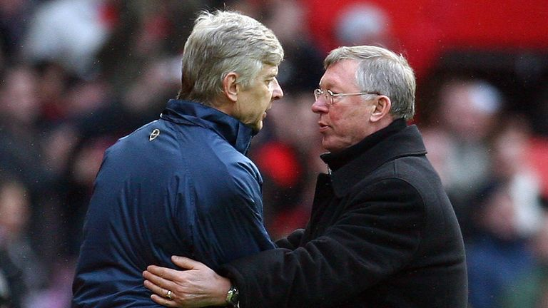Manchester United manager Sir Alex Ferguson (R) shakes hands with Arsenal manager Arsene Wenger after a Premier League game at Old Trafford in 2008