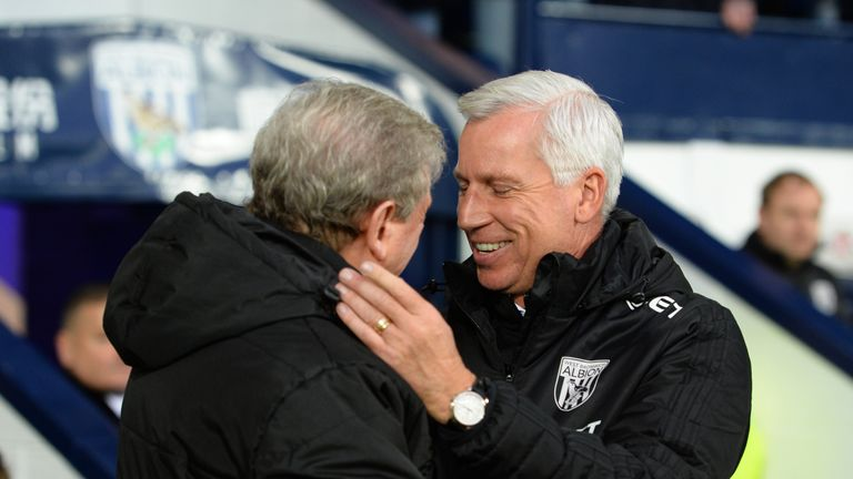 New West Brom boss Alan Pardew, (right) shakes hands with his Crystal Palace counterpart and Roy Hodgson ahead of kick-off at The Hawthorns