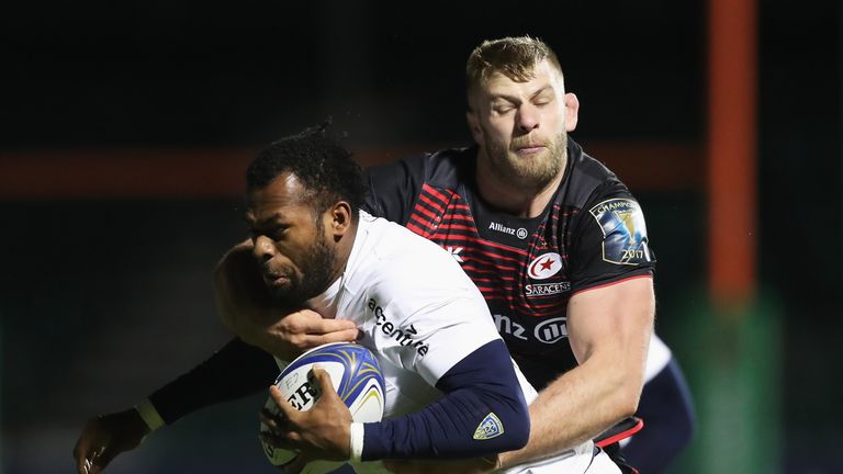 BARNET, ENGLAND - DECEMBER 11:  Alivereti Raka of Clermont Auvergne is tackled by George Kruis of Saracens during the European Rugby Champions Cup match be