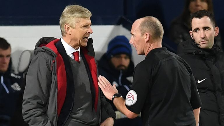 Arsene Wenger has strong words with Mike Dean at the Hawthorns