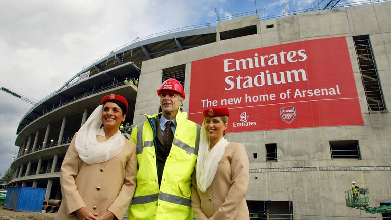 Wenger poses in front of Arsenal's new home - the Emirates Stadium