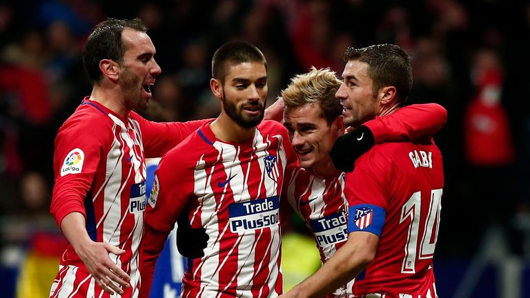 MADRID, SPAIN - DECEMBER 02: Antoine Griezmann (2ndR) of Atletico de Madrid celebrates scoring their second goal with teammates Gabi Fernandez (R); Yannick