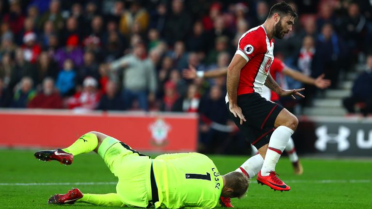 Austin clashed with Lossl in the first half at St Mary's