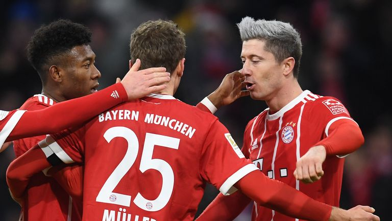 Robert Lewandowski (right) scored in the comeback victory for Bayern